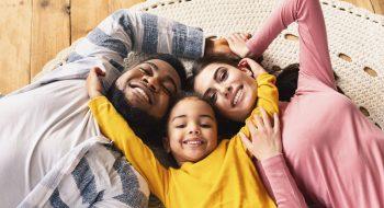 family-evening-multiracial-family-daughter-hugging-GHEWGPU.jpg